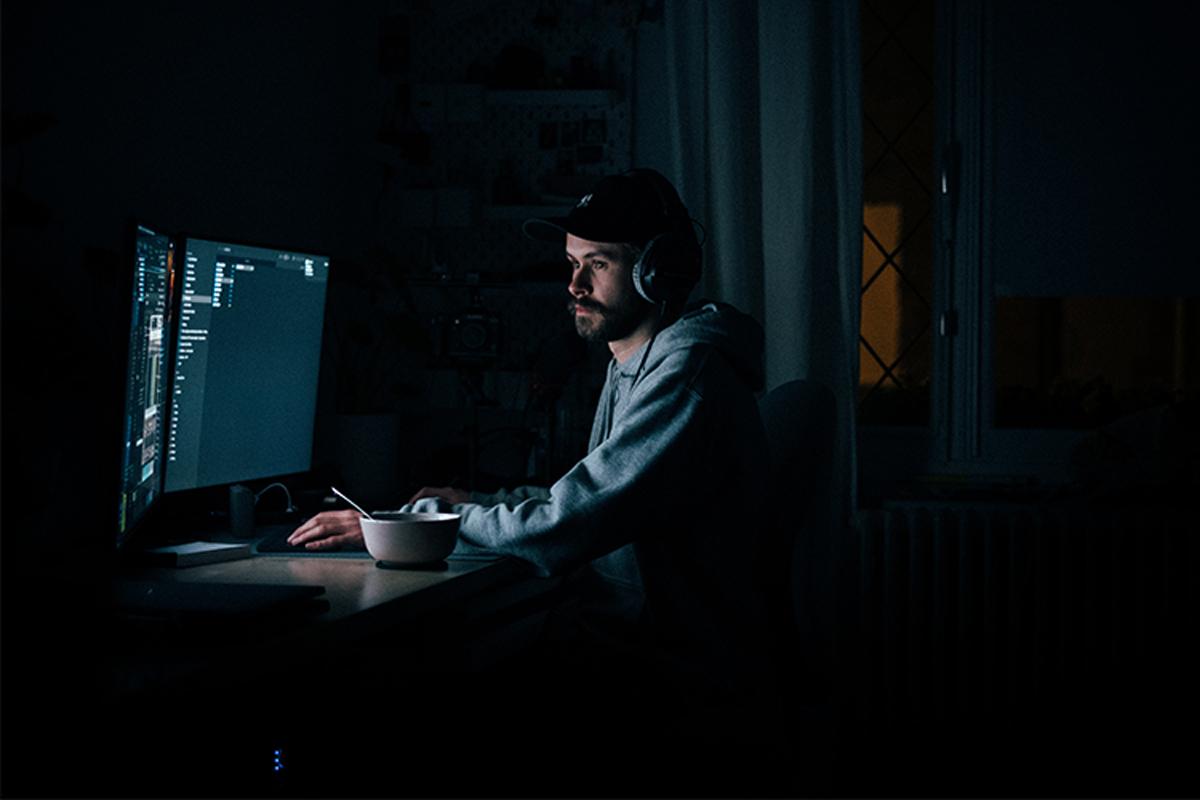 Man working in the dark