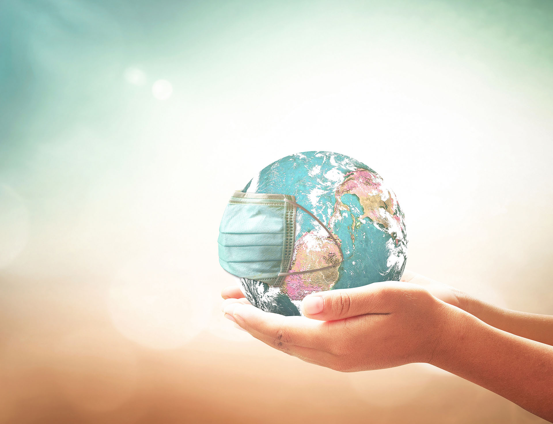 Person holding the world in their hands.