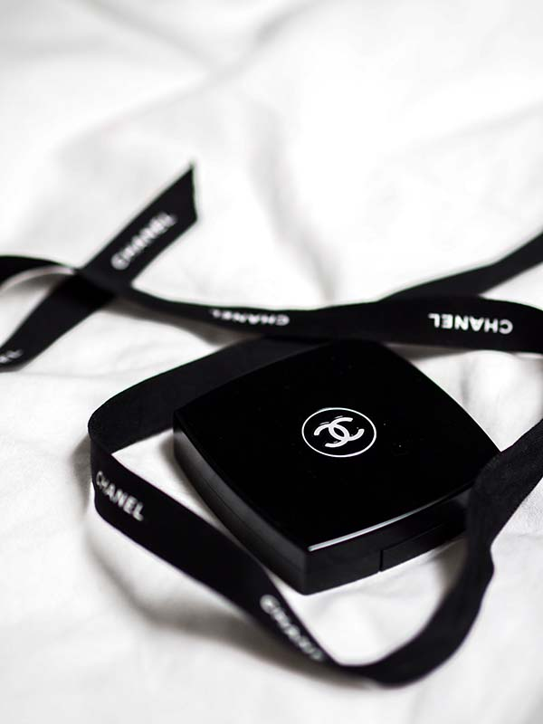 Photo of the Chanel logo on a box. By Laura Chouette/Unsplash.