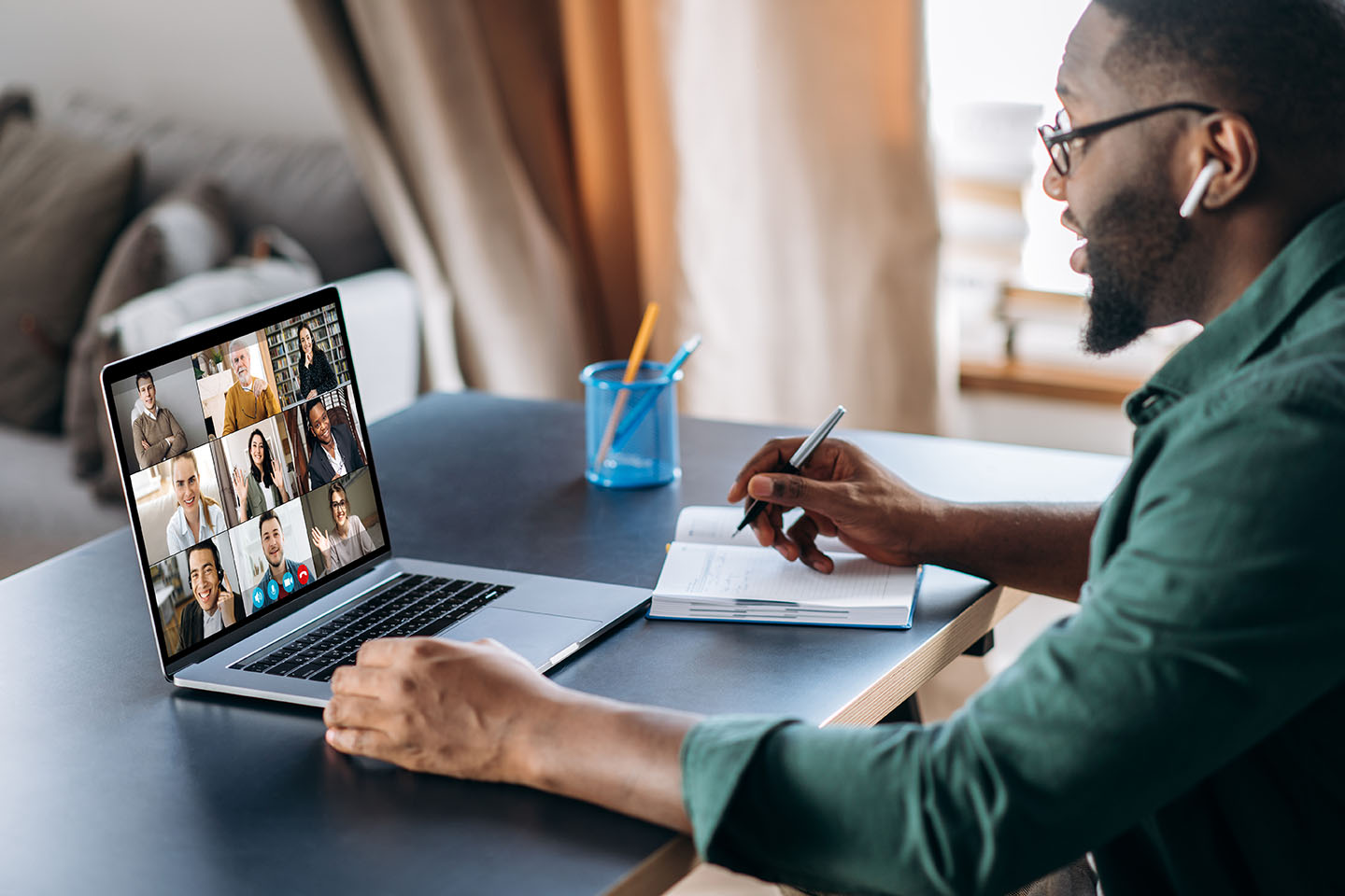 Online business briefing. Employee speak on video call with diverse colleagues, on laptop screen diverse business people, meeting online, group brainstorm.