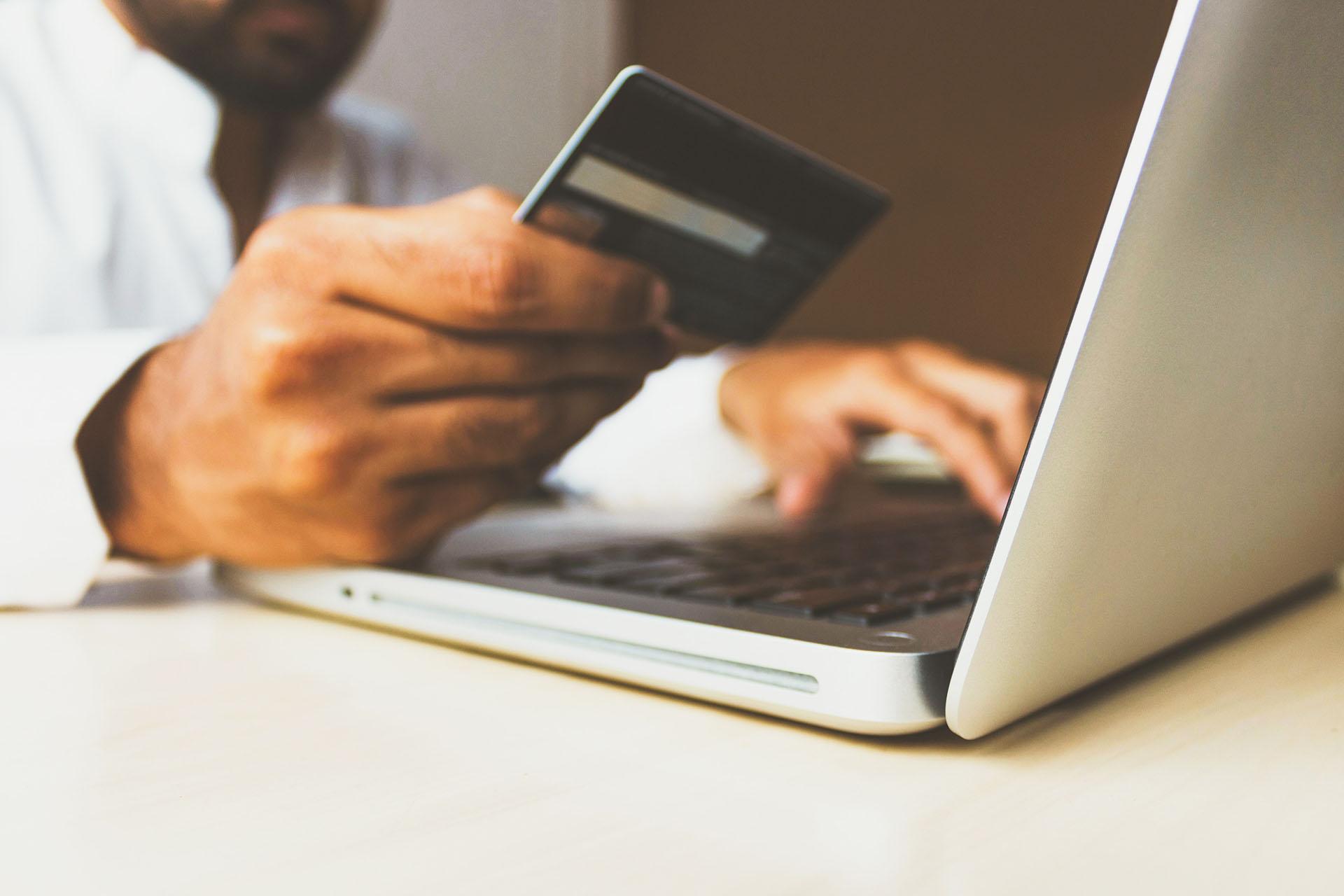 Man buying something with a credit card online. Photo byrupixen.comonUnsplash.