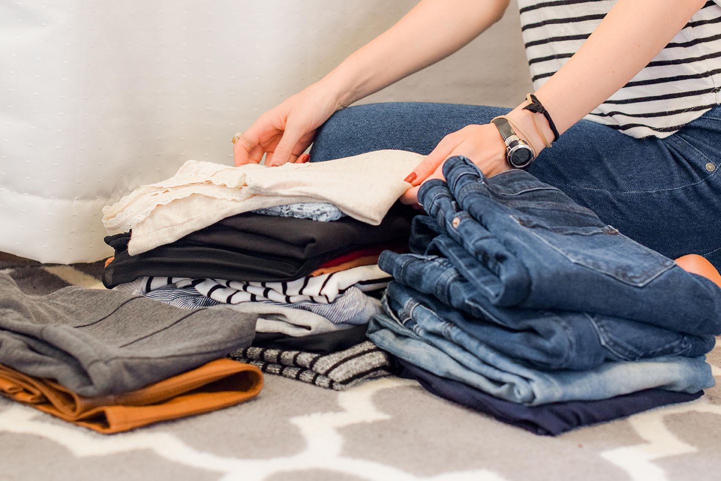 Woman folding her clothing.