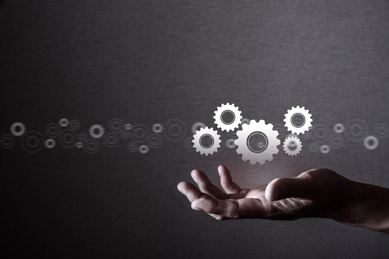 Human manipulating gears, technology.